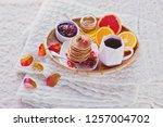 pancakes breakfast in bed... | Shutterstock . vector #1257004702