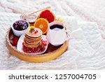 pancakes breakfast in bed... | Shutterstock . vector #1257004705