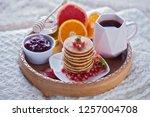 pancakes breakfast in bed... | Shutterstock . vector #1257004708