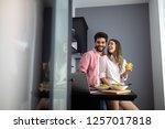 couple enjoying breakfast time... | Shutterstock . vector #1257017818