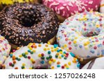 donuts covered with icing ... | Shutterstock . vector #1257026248
