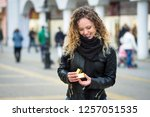 young woman opening a gift box... | Shutterstock . vector #1257051535