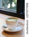 green tea latte. latte coffee... | Shutterstock . vector #1257077008