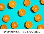 top view fresh orange slices on ... | Shutterstock . vector #1257092812