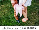 young parents hold baby romper. ... | Shutterstock . vector #1257104845