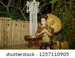 lao girl dressed in traditional ... | Shutterstock . vector #1257110905