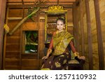 lao girl dressed in traditional ... | Shutterstock . vector #1257110932