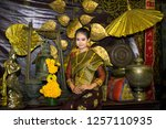 lao girl dressed in traditional ... | Shutterstock . vector #1257110935