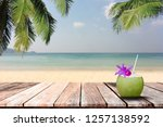 cocktail of coconuts on wooden... | Shutterstock . vector #1257138592