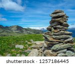 cairn in front of the mountains  | Shutterstock . vector #1257186445