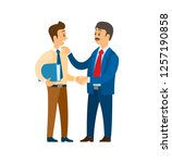 boss praising worker at job ... | Shutterstock .eps vector #1257190858