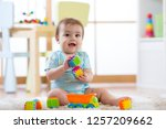 baby boy playing toys in... | Shutterstock . vector #1257209662