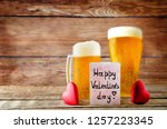 glass of cold light beer with... | Shutterstock . vector #1257223345