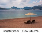 sunbeds and umbrella on the...   Shutterstock . vector #1257233698