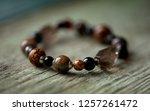bracelet made of natural stones. | Shutterstock . vector #1257261472