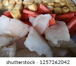 close up fresh fish fillet and... | Shutterstock . vector #1257262042