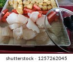 close up fresh fish fillet and... | Shutterstock . vector #1257262045
