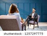 handsome male psychologist... | Shutterstock . vector #1257297775