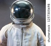 white astronaut or spaceman... | Shutterstock . vector #1257305698
