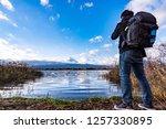 photographer or traveller using ... | Shutterstock . vector #1257330895