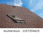 Roof With Mansard Windows And...