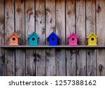 Colorful Birdhouses On A Barn...