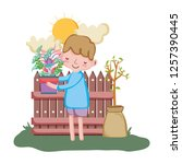 little boy lifting houseplant... | Shutterstock .eps vector #1257390445