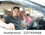 young muslim family   transport ... | Shutterstock . vector #1257454468