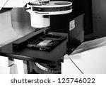 science slide under fluorescent microscope black and white - stock photo