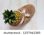 one ripe big pineapple in a... | Shutterstock . vector #1257462385