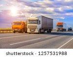 trucks goes on highway in... | Shutterstock . vector #1257531988