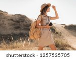 stylish young woman in khaki... | Shutterstock . vector #1257535705