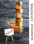 a supermarket cart loaded with... | Shutterstock . vector #1257547858