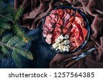 overhead view of a christmas... | Shutterstock . vector #1257564385