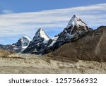 three sisters nirekha  6169 m   ... | Shutterstock . vector #1257566932