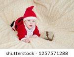 baby boy in santa costume... | Shutterstock . vector #1257571288