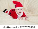 baby boy in santa costume... | Shutterstock . vector #1257571318