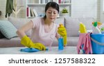 lady in protective gloves doing ... | Shutterstock . vector #1257588322