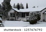 wonderful white house in snowy... | Shutterstock . vector #1257676792