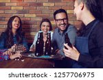 cheerful group of friends... | Shutterstock . vector #1257706975