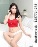young asian woman in bikini in... | Shutterstock . vector #1257714298