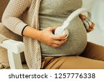 The impact of music. A pregnant woman wanting her future baby listen to the music