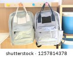 two kid backpacks hanging with... | Shutterstock . vector #1257814378