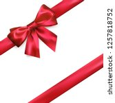 shiny red silk bow and ribbon... | Shutterstock . vector #1257818752