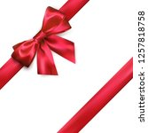 shiny red silk bow and ribbon...   Shutterstock . vector #1257818758