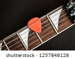orange pick on the electric... | Shutterstock . vector #1257848128