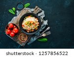 risotto with vegetables in a... | Shutterstock . vector #1257856522