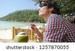 handsome young man in... | Shutterstock . vector #1257870055