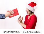 young woman receives christmas... | Shutterstock . vector #1257872338