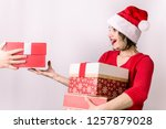 young woman receives a lot of ... | Shutterstock . vector #1257879028